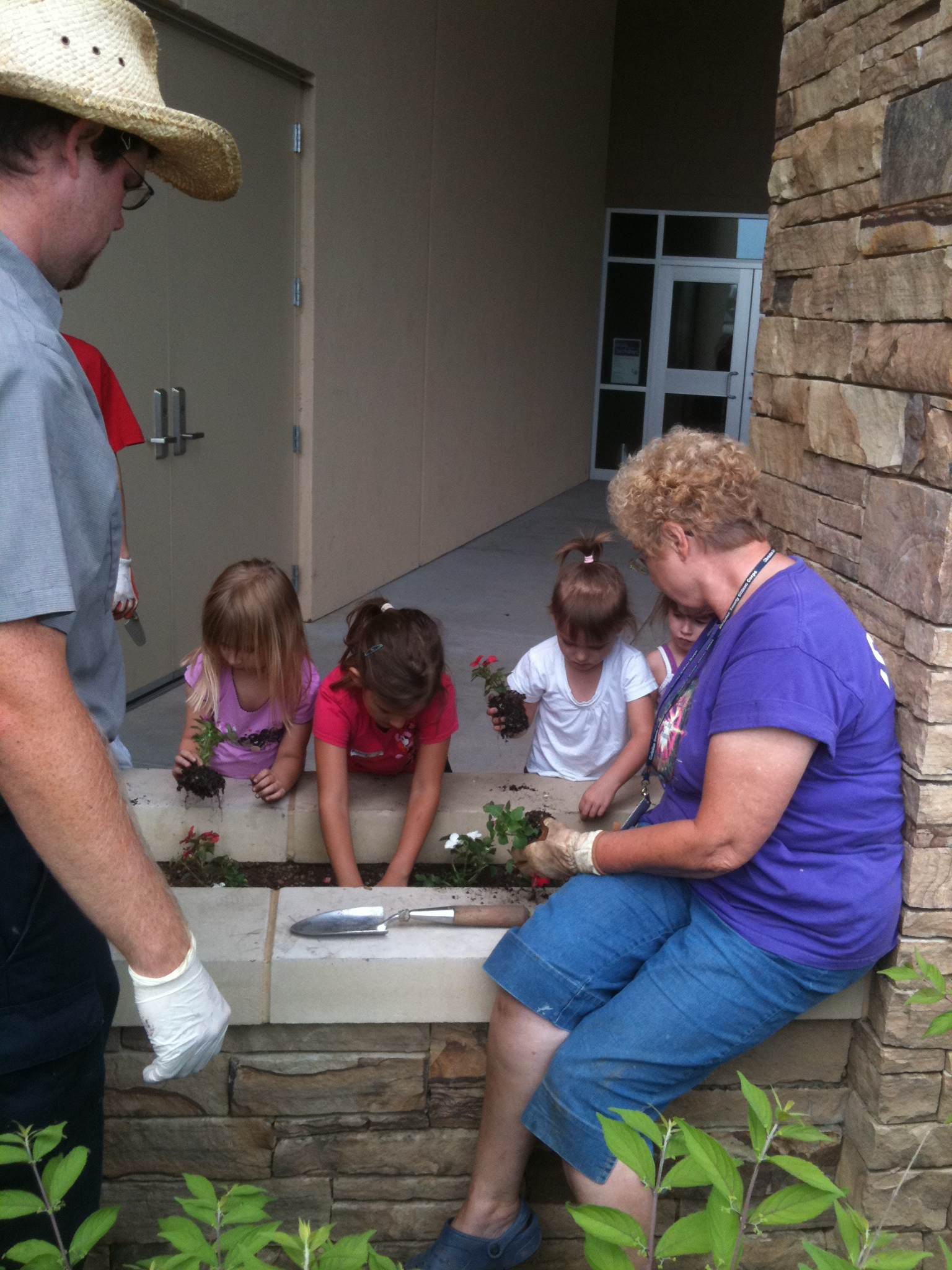 Helping Horticulture Dept. plant flowers